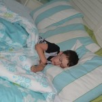 Blake napping....this was a daily ritual after lunch.  He loved his alone time watching a movie in our room.  :)