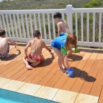 """painting"" with water on the deck....the kids LOVE doing this!"