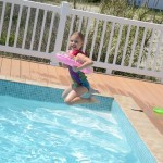 Elise jumping in the pool